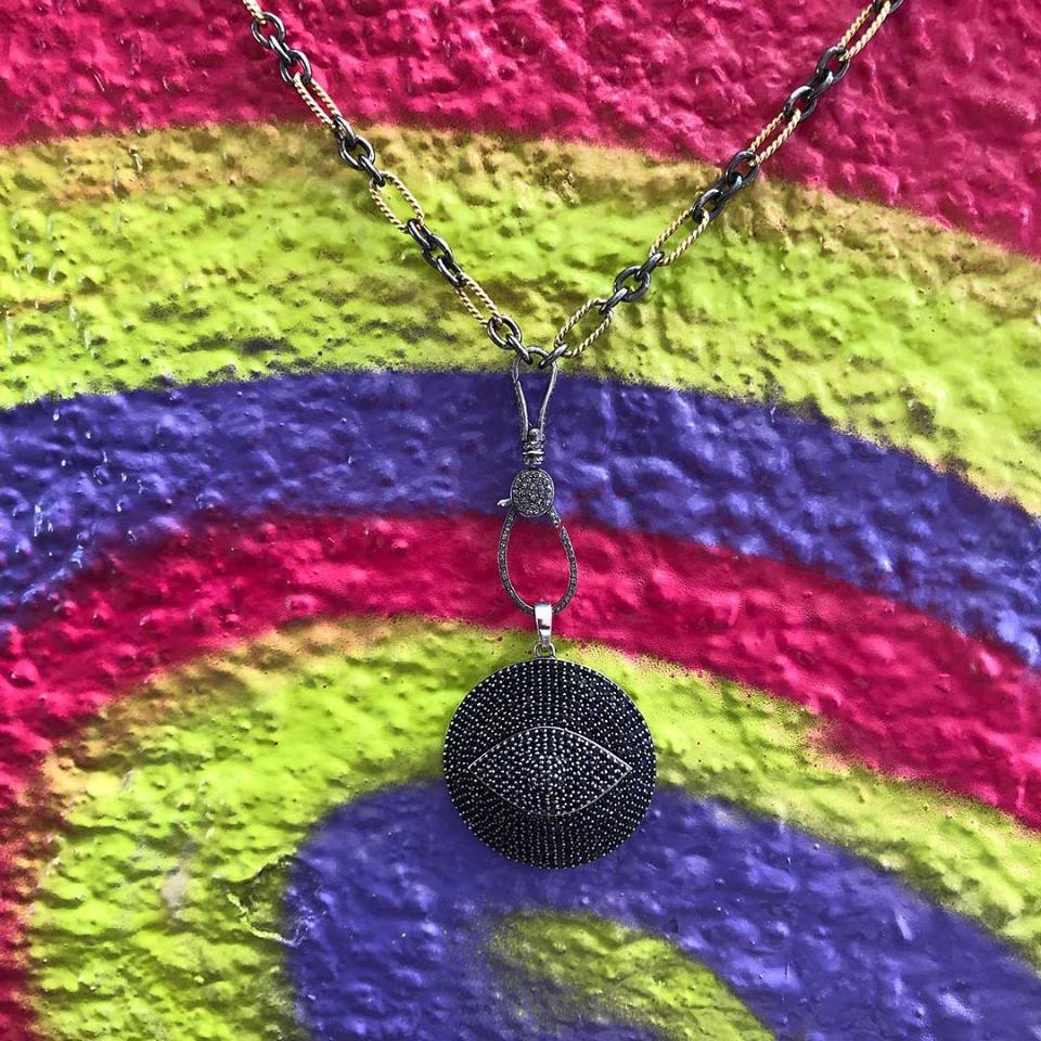 The brilliance of the diamond pendant